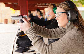 Woman with a pistol at a shooting range
